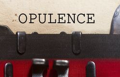Opulence  typed on an old vintage paper. With od typewriter font Stock Photo
