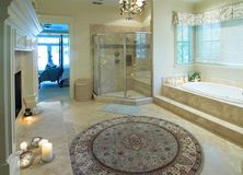 Opulent bathroom. With fireplace and glass shower Stock Photography