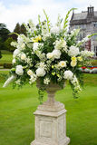 Opulent bouquet of flowers. Urn of opulent bouquet of flowers in manor gardens Royalty Free Stock Image