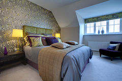 Opulent modern bedroom. Modern luxurious bedroom dressed with opulent fabrics Stock Photography