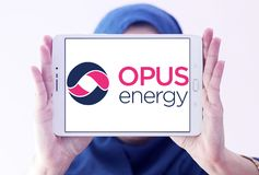 Opus Energy Limited logo. Logo of Opus Energy Limited on samsung tablet holded by arab muslim woman. Opus Energy supplies gas and electricity to businesses royalty free stock photos