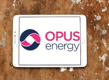 Opus Energy Limited logo. Logo of Opus Energy Limited on samsung tablet on wooden background. Opus Energy supplies gas and electricity to businesses across the stock photography