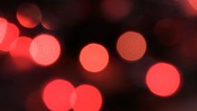 Opvlammende gekleurde lichten in een onduidelijk beeld Het bokeheffect Elektrische Kerstboomlichten Lengteklem 4K stock illustratie