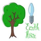 Ora della terra con la lampadina Fotografie Stock Libere da Diritti