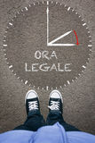 Ora Legale, Italian Daylight Saving Time on asphalt with two sho Royalty Free Stock Photography