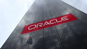 Oracle Corporation logo on a skyscraper facade reflecting clouds, time lapse. Editorial 3D rendering. Oracle Corporation logo on a skyscraper facade reflecting stock video footage