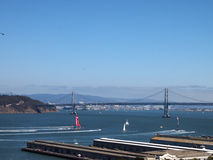 Oracle Team USA and New Zealand Team race toward the Bay Bridge Stock Images