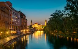 ORADEA, ROMANIA - 28 APRIL, 2018: Crisul River and Oradea City Hall in background at sunset.  royalty free stock photography