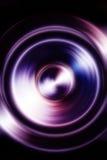 Orador da música com efeito do borrão da cor do fractal no fundo preto fotografia de stock