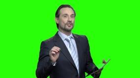 Orador no seminário do negócio video estoque