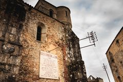 Stone panel where it is written - SILENCE here hundreds of women. ORADOUR SUR GLANE, FRANCE - December 03, 2017 : on the church destroyed by fire a stone panel royalty free stock images