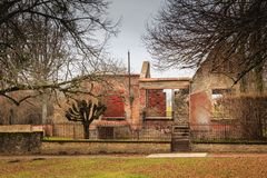 Ruined house destroyed by fire following the massacre of the ent Stock Photography