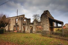 Ruined house destroyed by fire following the massacre of the ent Royalty Free Stock Images