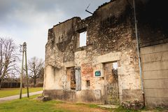 Ruined house destroyed by fire following the massacre of the ent Royalty Free Stock Photography