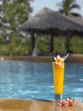 Orage fresh juice in the pool Royalty Free Stock Images