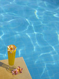 Orage fresh juice in the pool Stock Images