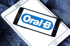 Oral-B logo. Logo of toothpaste brand Oral-B on samsung mobile on samsung tablet stock photo