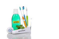 Oral care essential products tapered toothbrush, toothpaste, mou Royalty Free Stock Photos