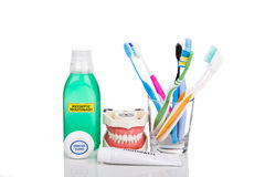 Oral care essential products tapered toothbrush, toothpaste, mouthwash, dental floss. Oral care essentials soft tapered bristle toothbrush, toothpaste, mouthwash royalty free stock photos