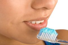 Oral dental hygiene brush. Close up of woman brushing her teeth with toothbrush and blue toothpaste Stock Photos
