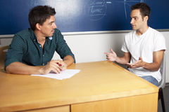 Oral examination. Student explaining with hands during an oral exam Royalty Free Stock Image