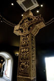 Oral History. Standing in the exhibition hall at Clonmacnoise, Ireland, is the Cross of Scriptures. Dated from 900 AD it is one of the finest high crosses in Royalty Free Stock Photo