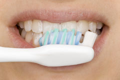 Oral hygiene. With tooth brash Royalty Free Stock Image