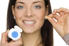 Oral hygiene. Beautiful young woman doing oral hygiene Royalty Free Stock Images