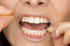 Oral hygiene. Woman is doing oral hygiene Royalty Free Stock Photos