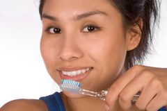 Oral hygiene - brushing teeth. Teenager girl brushes her teeth. She is already adult woman and can handle her dental hygiene routine Stock Images