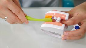 Oral hygiene for dental braces. Orthodontic Treatment concept. Teaching dental care. Dentist showing on jaw model how to