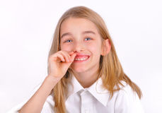 Oral hygiene. Little girl opened her mouth and shows their teeth and gums Royalty Free Stock Image