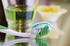 Oral hygiene products on a mirror surface Stock Photography