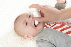 Oral Spray. Baby getting medicine through oral spray royalty free stock photo