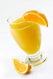 Orang Juice with Orange. Glass of orange juice with garnish on light background stock images