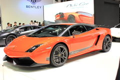 Orang sport car on fair stand Royalty Free Stock Image