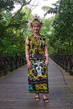 Orang Ulu woman full colourful traditional costume attire on the way for anniversary celebration in Mulu, Borneo Sarawak, Malaysia