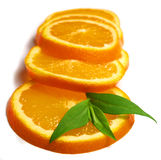 Orange. Macro photo of orange slices with leaves Stock Photo