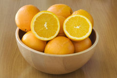 Orange. In a wood basket Royalty Free Stock Images