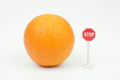 Orange. And sign stop on a white background Stock Photos