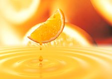 Orange. A slightly overexposed orange, juice drops Stock Images