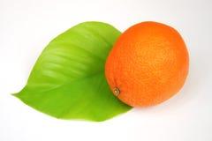 Orange. A orange on a green leaf Royalty Free Stock Photos