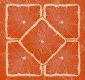 Orange. Bright orange background from slices of juicy oranges Stock Photography