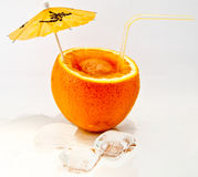 Orange. With cocktail umbrella, straw and ice cubes Royalty Free Stock Photo