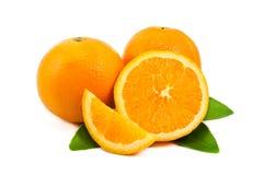 Orange. Slice of orange with green leaf on white background Royalty Free Stock Photo
