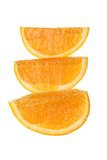 Orange. Three  Appetizing   slices   of    orange   on   white  background Stock Image