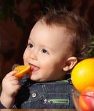 Orange. Baby eating a orange at home Royalty Free Stock Photo