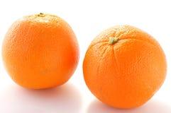 Orange. Two Oranges on the white background Royalty Free Stock Images