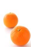 Orange. Two Oranges on the white background Royalty Free Stock Photos