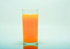 Orange. In glass on a white background royalty free stock images